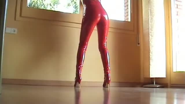 SEXY LEGS WALKING AND WAITING IN RED LATEX