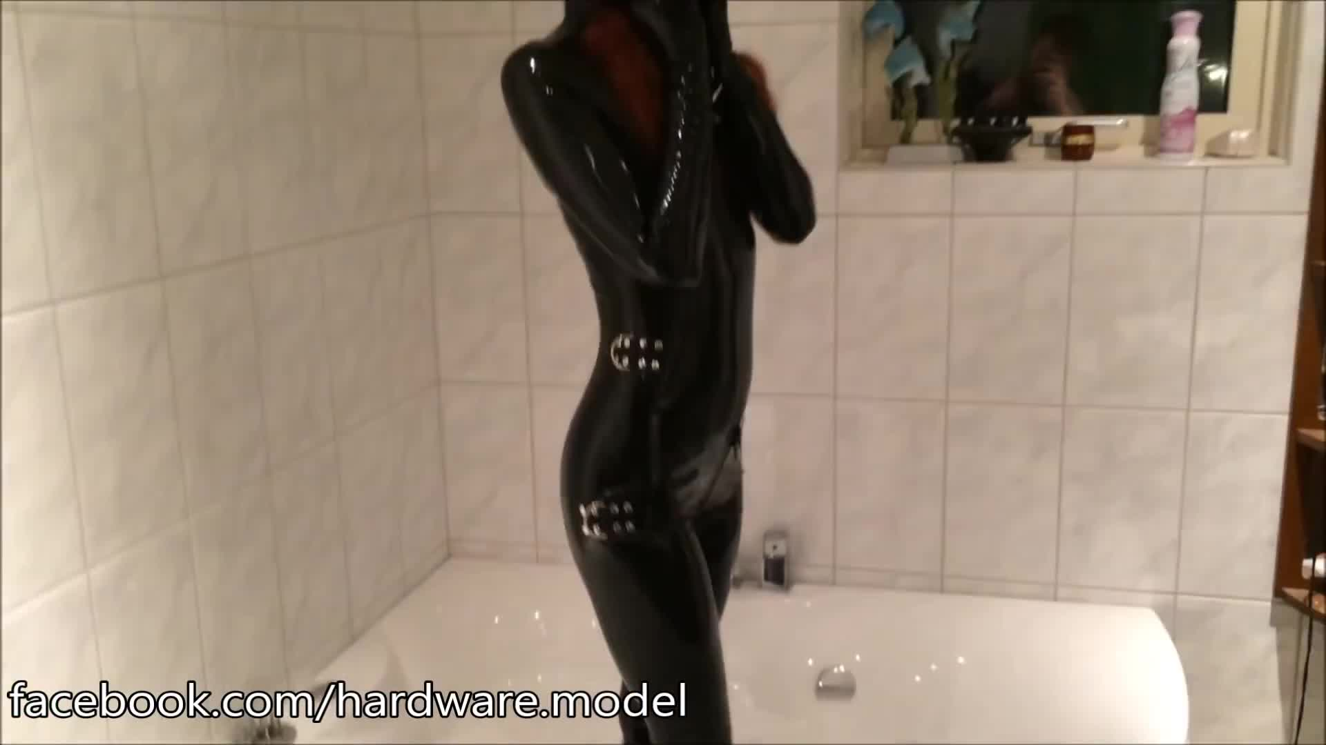 Latex straitjacket catsuit teaser