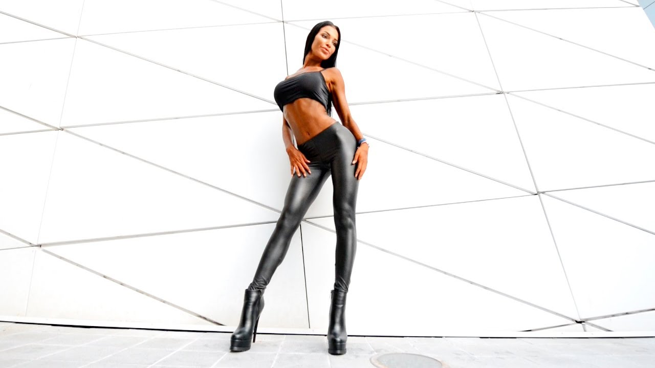 Walking in boots Black leather leggings. high heeled shoes long legs