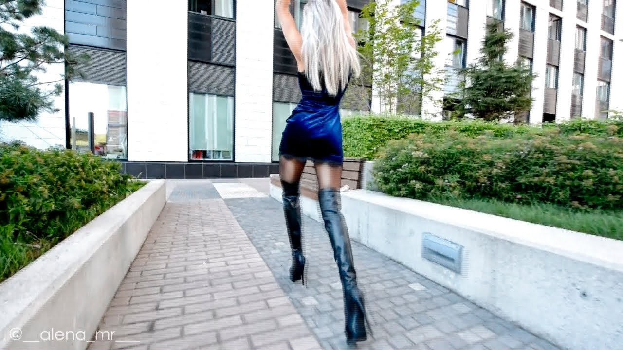 Walking in Pantyhose Fashion. Blond Mini dress long legs.