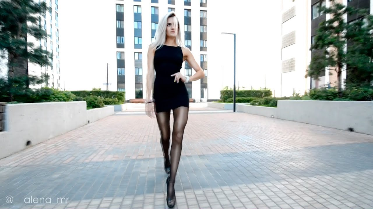 Walking Pantyhose Fashion. Black Mini dress long legs.