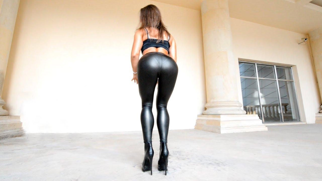 Walking in boots Black leather leggings with high heels. Bikini posing