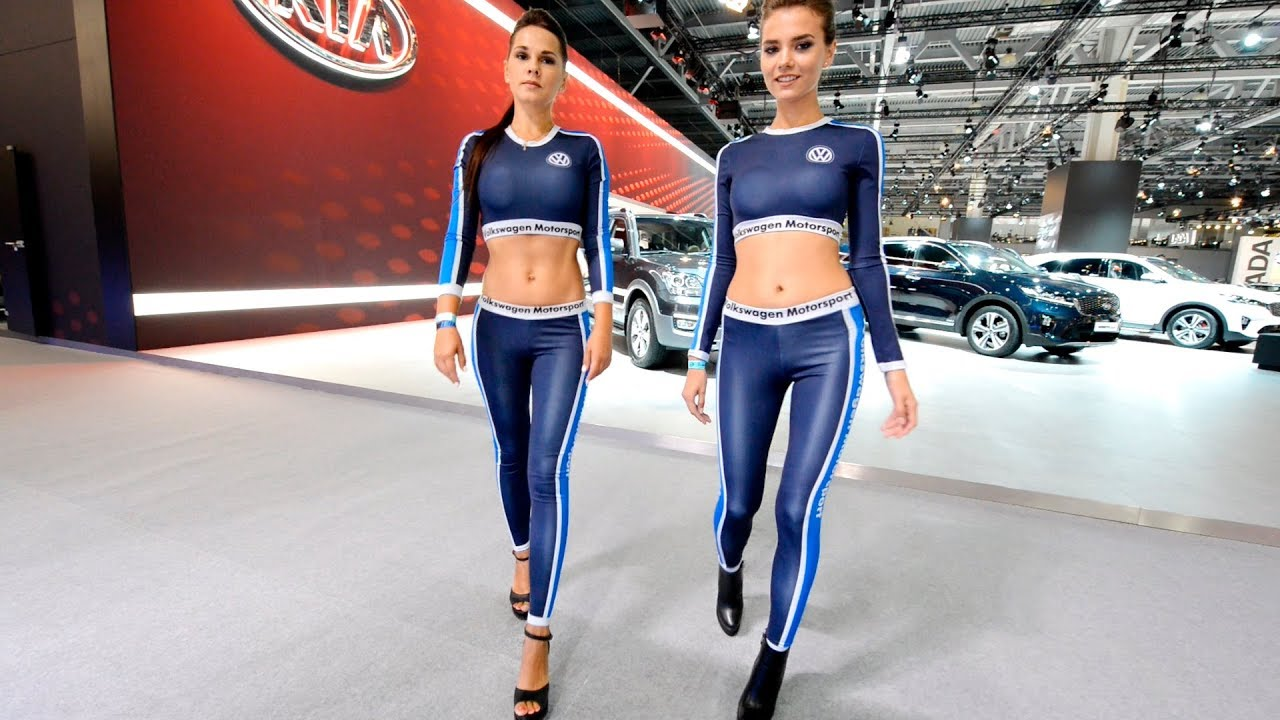 Girls, walking in high heels. motor show