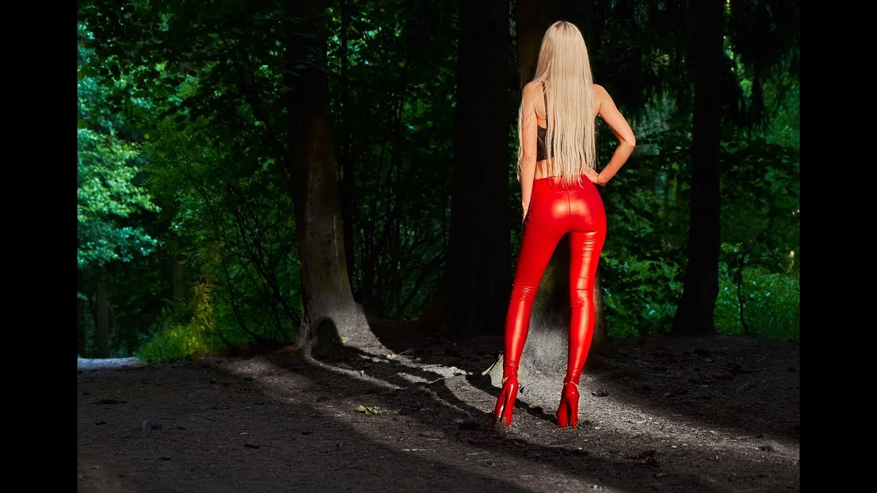 walking LADY in RED real tight leather leggings and high RED heels