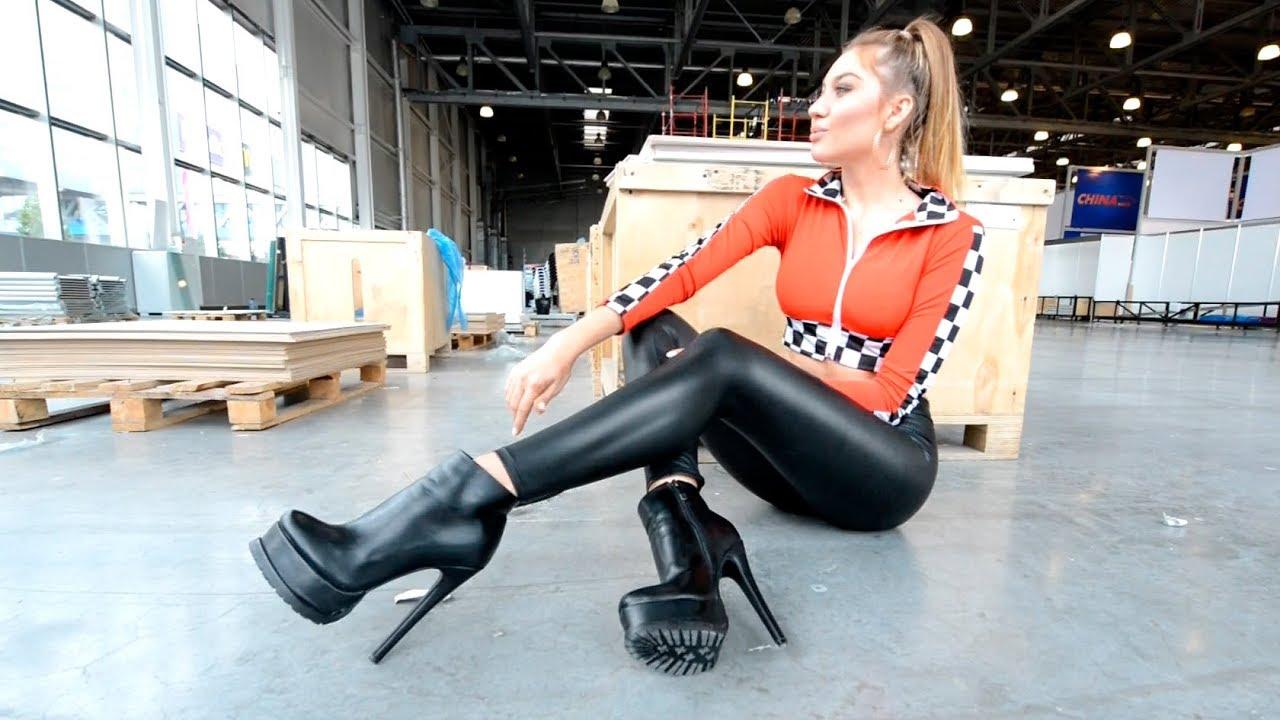 Black leather leggings. high heeled shoes long legs