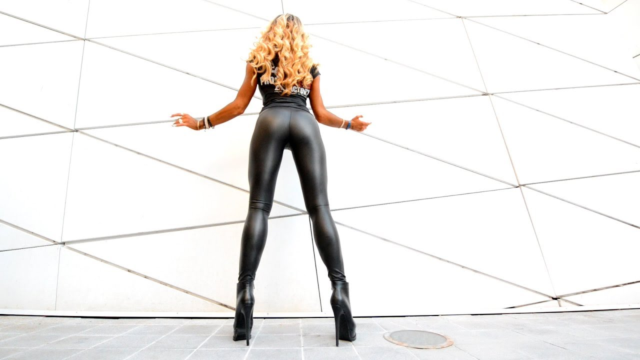 Walking in boots in leather leggings. high heeled shoes long legs