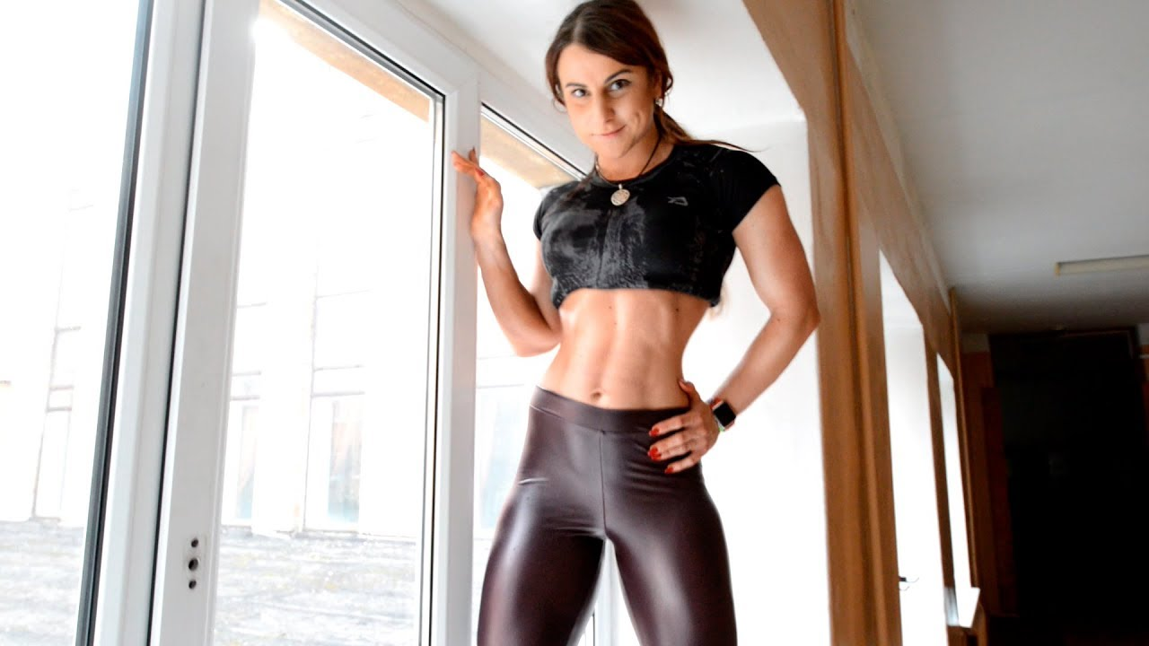 Fitness model leather leggings. high heeled shoes.